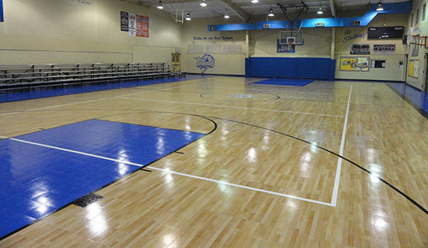 Basketball courts gym flooring in houston sport court for Indoor basketball court flooring cost
